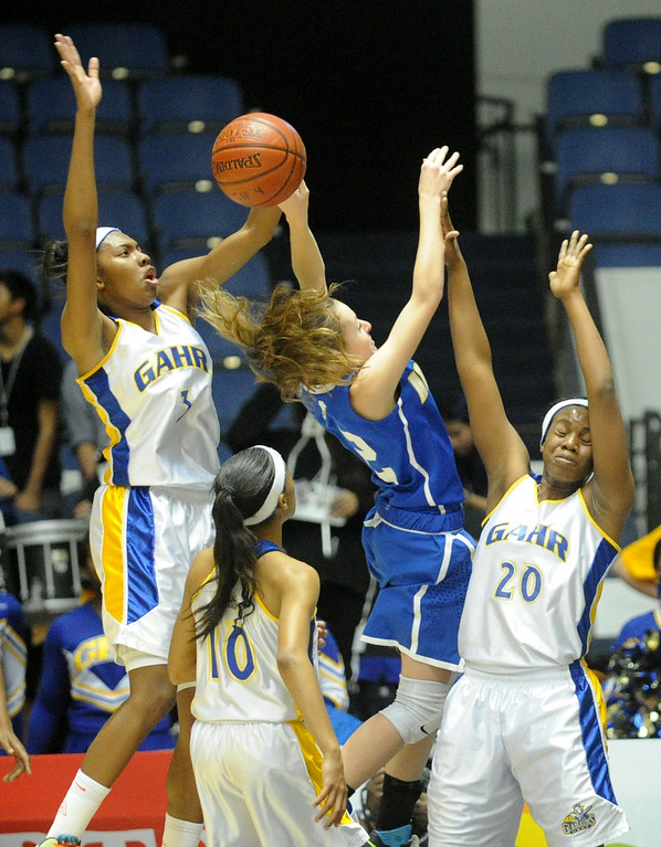. 02-27-2012--(LANG Staff Photo by Sean Hiller)- Gahr vs. Agoura in Wednesday\'s girls basketball D3AAA title game at Anaheim Arena. Gahr\'s Jewelyn Sawyer (3) fouls Agoura\'s Natalie Bradley (12) as she defends with teammate Chidera Agu (20).