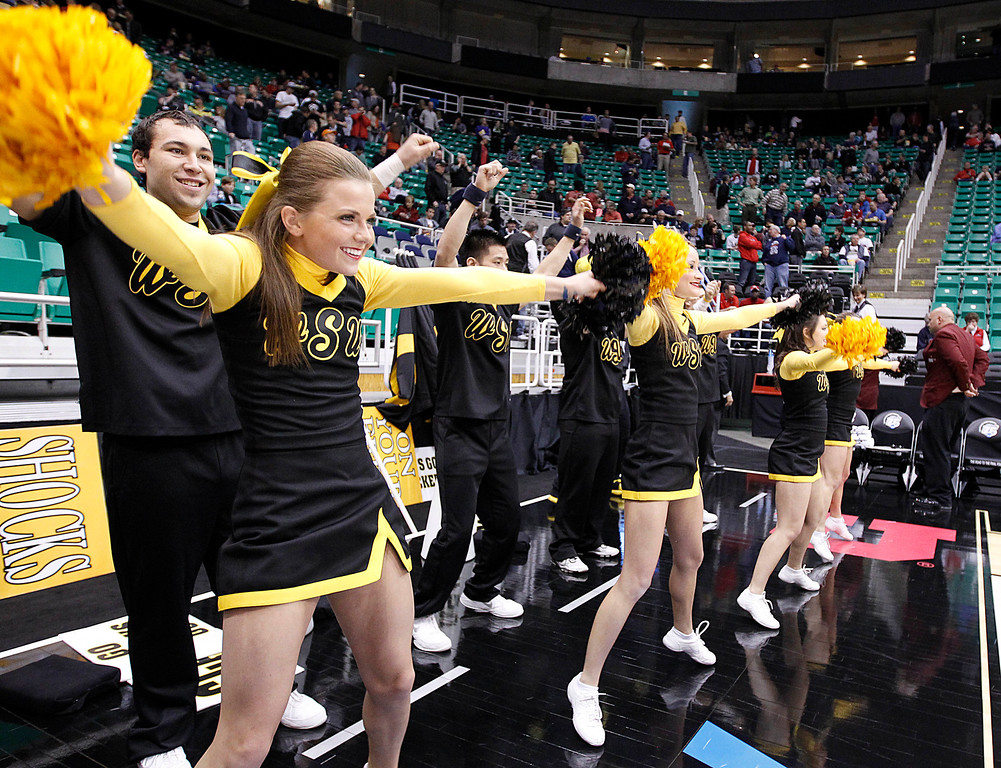 . Wichita State cheerleaders preform before their game against Pittsburgh in a second-round game in the NCAA college basketball tournament in Salt Lake City Thursday, March 21, 2013. (AP Photo/George Frey)