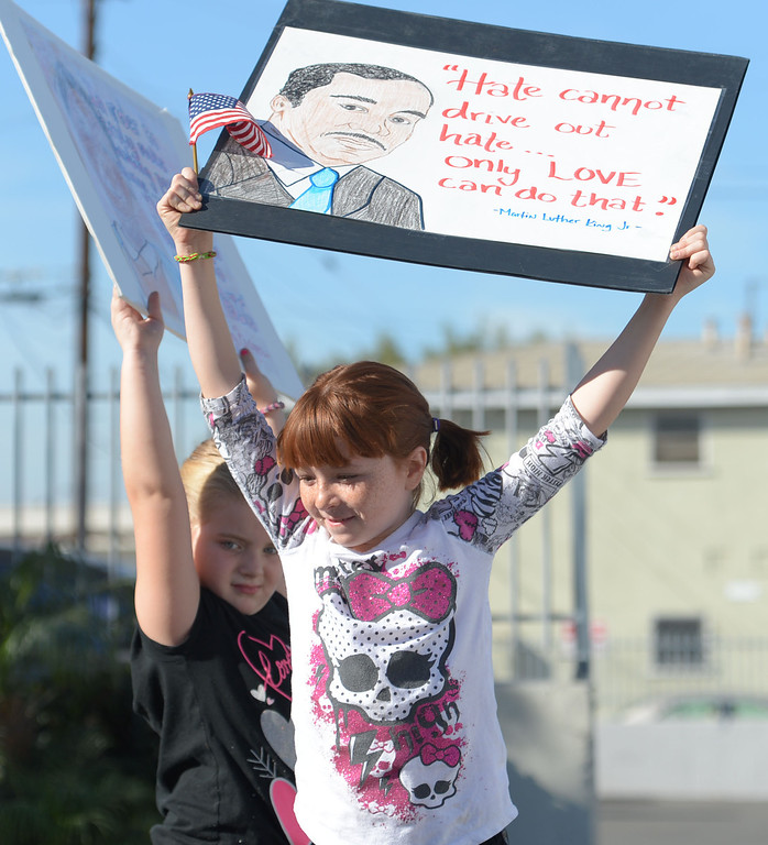 . The 26th Annual Martin Luther King, Jr., Peace & Unity Parade Saturday, January 18, 2014, Long Beach, CA.   Children carry hand made signs with King\'s quotes on them. Photo by Steve McCrank/Daily Breeze