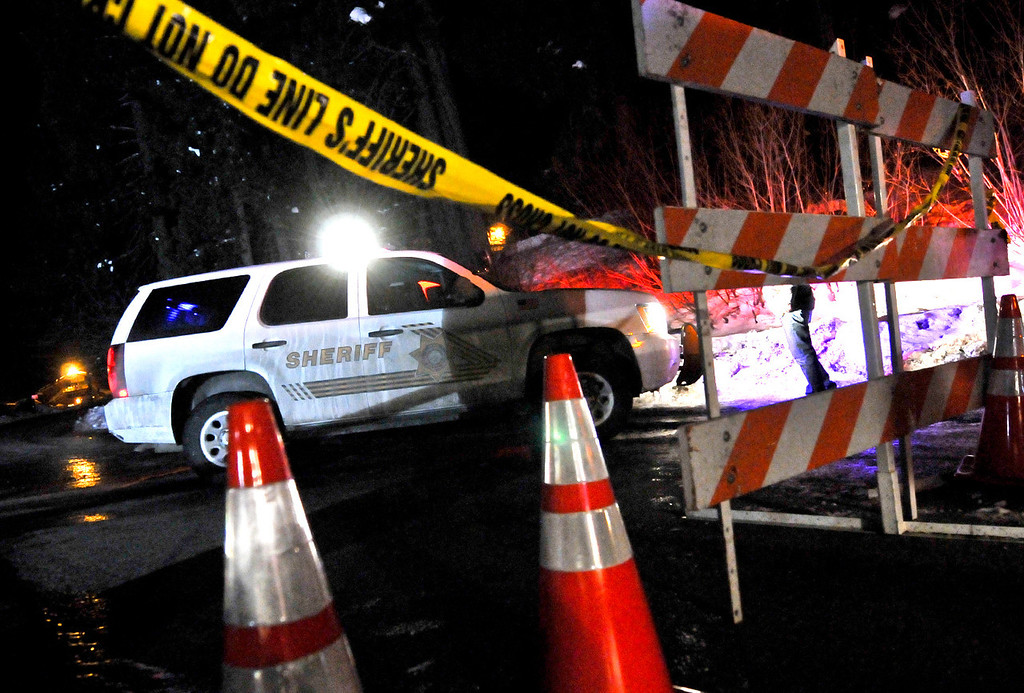 . Sheriff\'s deputies close the road where fugitive ex-cop Christopher Dorner allegedly stayed in a cabin near the original manhunt command post at Bear Mountain Resort on Club View Drive in Big Bear on Tuesday, Feb. 12, 2013. (Rachel Luna / Staff Photographer)