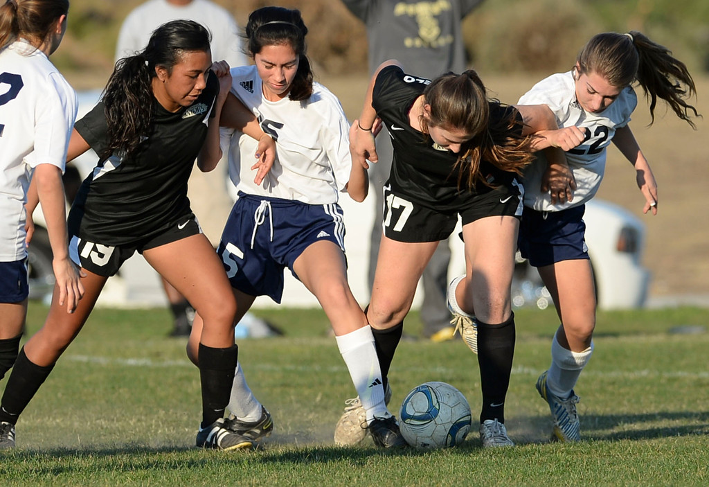 . Bishop Montgomery\'s Keilani Calinao and Natalie DiAngelo (17) get tangled with Mary Star\'s Gina Rios (15) and Dori Lindeman (22) in a Del Rey League girls soccer game Thursday, January 16, 2014, San Pedro, CA. Regulation time resulted in a 1-1 tie, and then Bishop Montgomery scored two goals in overtime. Photo by Steve McCrank/Daily Breeze