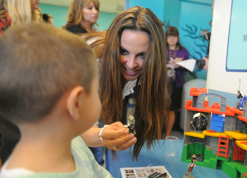 ". 04-18-2013-(LANG Staff Photo by Sean Hiller)-Toyota Grand Prix Celebrities visited Miller�s Children�s Hospital to visit the children they are raising money for through the ""Racing for Kids.\"" Patient Kevin Renteria meets celebrity driver Kate del Castillo."