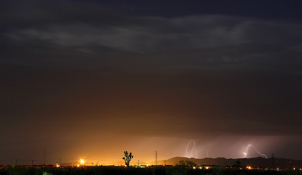 Description of . Lightning strikes and lights up the skies as monsoon storms pass throughout the high deserts area early Monday morning, Aug. 19, 2013 - Lake Los Angeles CA. Photo by Gene Blevins/LA Daily News