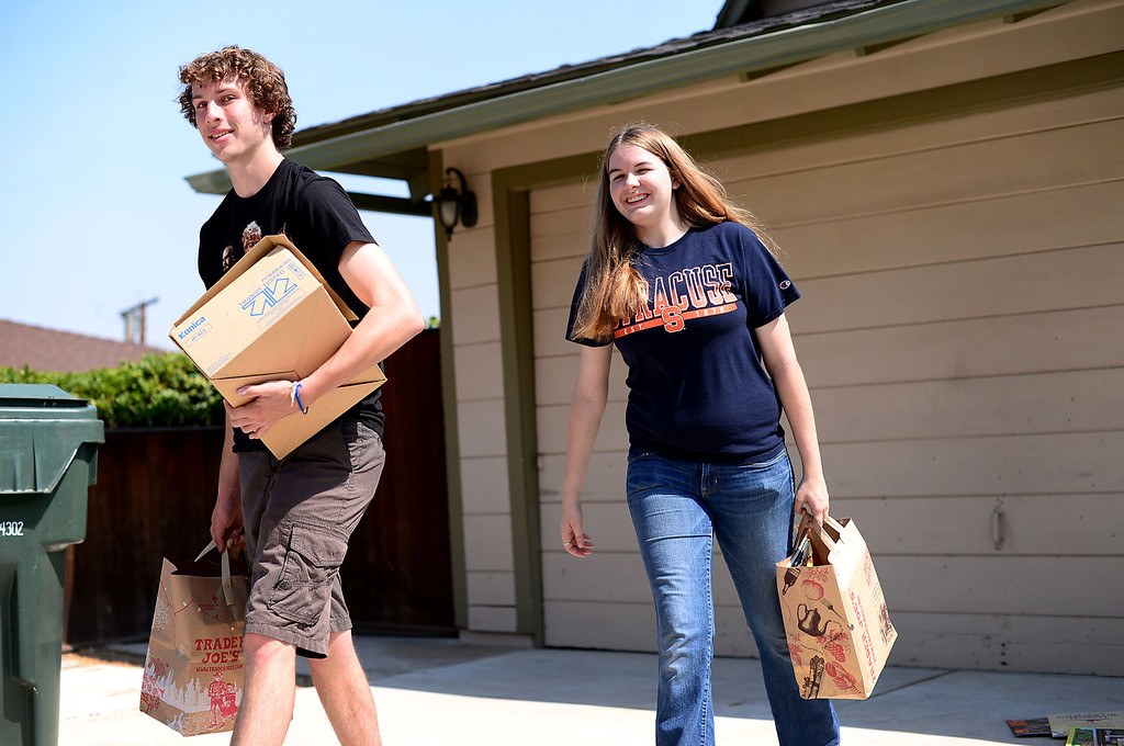. Stephanie Cox, 18, who created five free book nooks in Monrovia for her Girl Scout Gold Award Project, leaves her home with books for the Monrovia Fire Department\'s free library box with Travis Stone. Stone, 18,  helped Cox with the project and runs the Facebook page. (SGVN/Staff Photo by Sarah Reingewirtz)