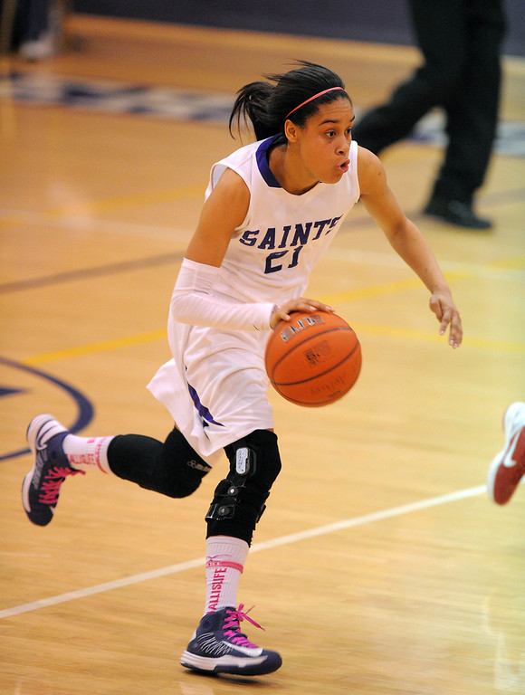 . LONG BEACH - 02/14/13 - (Photo: Scott Varley, Los Angeles Newspaper Group)  CIF-SS Div 4AA girls basketball playoff between Marymount Sailors and host St. Anthony Lady Saints. SA\'s Jordan Jackson drives down the court after a turnover.
