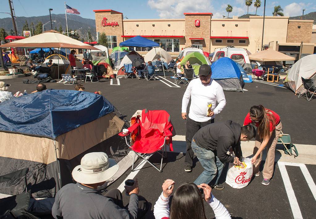 Description of . Chick-fil-A contestants camp out at the company's new Azusa location to receive 52 free-meal coupons Feb. 20, 2013.  Contestants waiting for the day and staying overnight are treated to games and free meals.  (SGVN/Staff photo by Leo Jarzomb)