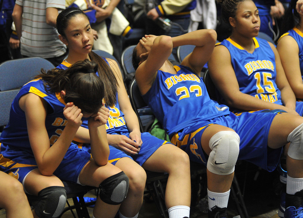 Description of . Bishop Amat players react to their loss to Canyon Springs in the CIF-SS Division 1A girls basketball finals at the Anaheim Arena on Friday March 1, 2013. Canyon Springs beat Bishop Amat 48-46. (SGVN/Staff Photo by Keith Durflinger)