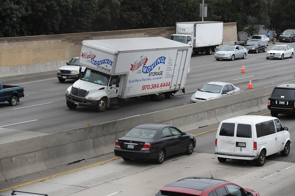 . Cars pass moving van at the scene of an accident that blocked traffic on the eastbound Ventura (101) Freeway by White Oak Avenue, Wednesday afternoon, April 24, 2013. (Michael Owen Baker/Staff Photographer)