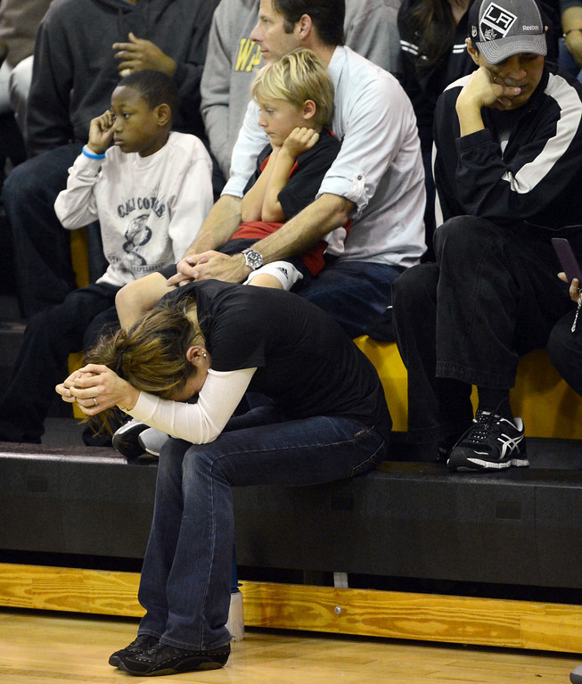 Description of . Bishop Montgomery fans look dejected as seconds run out against La Verne Lutheran in a CIF SS Division IV-AA semifinal game in Torrance Friday night. Lutheran stunned Bishop Montgomery 63-59, ending their unbeaten season. 20130222 Photo by Steve McCrank / Staff Photographer