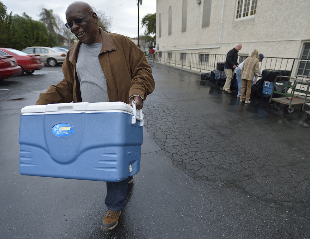 . LONG BEACH, CALIF. USA -- Volunteers Jackie Jackson loads up Meals on Wheels food for delivery on February 19, 2013, in Long Beach, Calif.  Photo by Jeff Gritchen / Los Angeles Newspaper Group