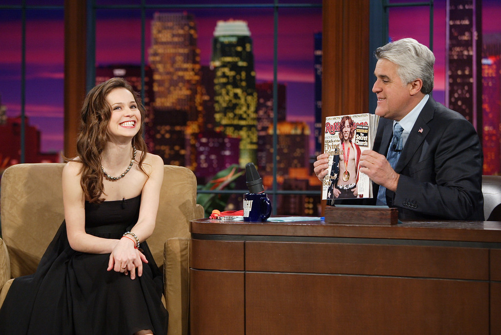 """. ** CORRECTS DATE TO TUESDAY, FEB. 28, 2006 **   In this photo released by NBC Universal, host Jay Leno, right, talks with Olympic silver medal-winning figure skater Sasha Cohen as he holds up the cover of Rolling Stone magazine showing Olympic gold medal-winning snowboarder Shaun White during taping of \""""The Tonight Show with Jay Leno\"""" Tuesday, Feb. 28, 2006 , in Burbank, Calif. (AP Photo/NBC Universal, Margaret Norton)  ** NO SALES **"""