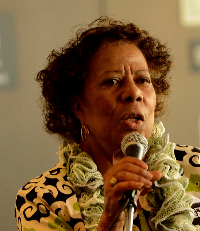Description of . Former 6th Ward councilwoman Betty Dean Anderson leads an audience in the singing of