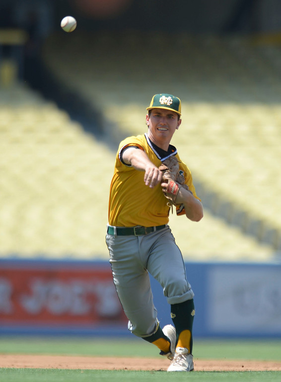 . Mira Costa\'s Jack Hadley (7) makes a play to first against Serra in the CIF-SS Division III championship baseball game Friday at Dodger Stadium. Serra won the title, 8-1. 20130531 Photo by Steve McCrank / Staff Photographer