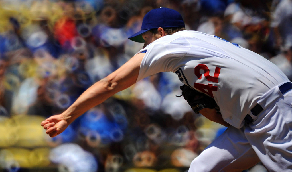 . Los Angeles Dodgers starting pitcher Clayton Kershaw throws to the plate against the San Diego Padres in the first inning of a baseball game in Los Angeles on Sunday, April 15, 2012.   (Keith Birmingham/Pasadena Star-News)