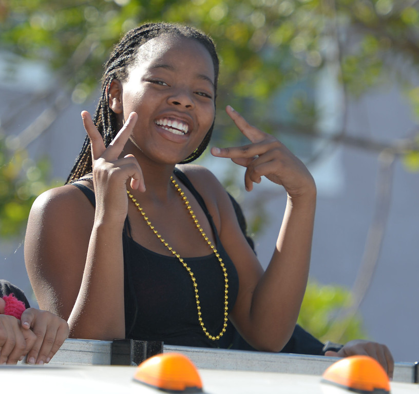 . The 26th Annual Martin Luther King, Jr., Peace & Unity Parade Saturday, January 18, 2014, Long Beach, CA.   Smiles and peace symbols are shown along the route. Photo by Steve McCrank/Daily Breeze
