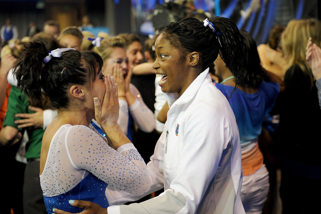 . Florida\'s Marissa King, left, and Ashanée Dickerson celebrate after hearing they won the NCAA Women\'s Gymnastics Championship Team Finals at Pauley Pavilion, Saturday, April 20, 2013. (Michael Owen Baker/Staff Photographer)
