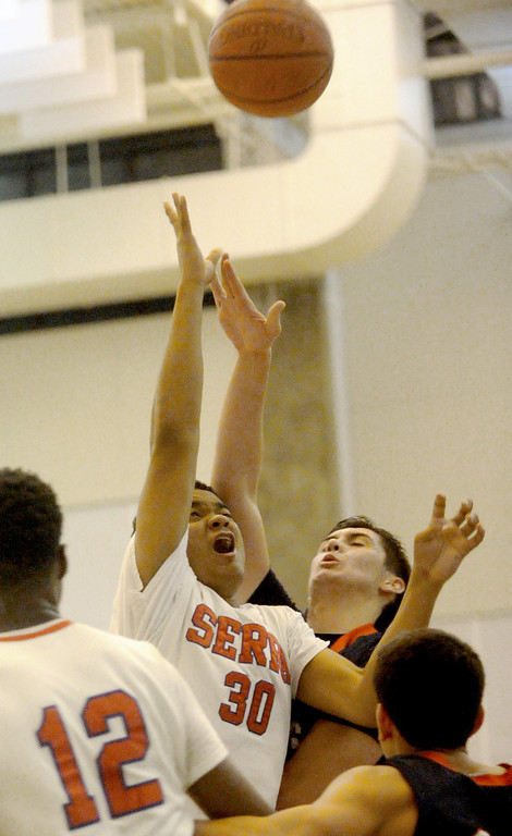 . 03-12-2013--(LANG Staff Photo by Sean Hiller)-Serra\'s Cedric Thomas tangles up with Pacific Hills\' Adam Plax (2) in Tuesday\'s boys basketball IV Southern California Regional semifinal at L.A. Southwest College.