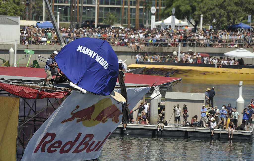 ". LONG BEACH, CALIF. USA -- Flugtag entry ""Mannywood\"" gets stuck on the ramp in Rainbow Harbor in Long Beach, Calif. on August 21, 2010. Thirty five teams competed in the Red Bull event where teams build homemade, human-powered flying machines and pilot them off a 30-foot high deck in hopes of achieving flight.  Flugtag means \""flying day\"" in German. They are on distance, creativity and showmanship..Photo by Jeff Gritchen / Long Beach Press-Telegram.."