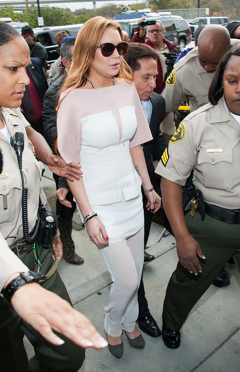 . LOS ANGELES, CA - MARCH 18:  Lindsay Lohan arrives to her trial for allegedly lying to police after a car crash, reckless driving and violating her probation for a 2011 jewelry theft conviction at Airport Branch Courthouse of Los Angeles Superior Court March 18, 2013 in Los Angeles, California.  If convicted Lohan could serve the remainder of her 245 day suspended sentence for her jewelry theft conviction.  (Photo by Valerie Macon/Getty Images)