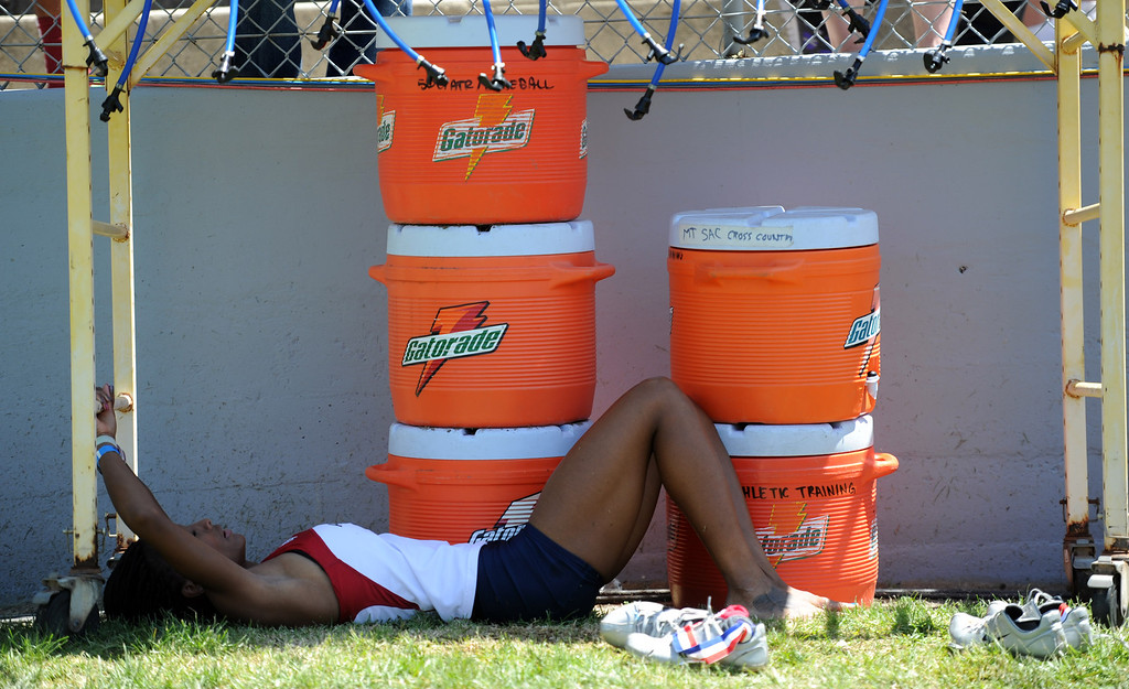 Description of . An athlete cools off after competing during the Mt. SAC Relays in Hilmer Lodge Stadium on the campus of Mt. San Antonio College on Saturday, April 20, 2012 in Walnut, Calif.    (Keith Birmingham/Pasadena Star-News)