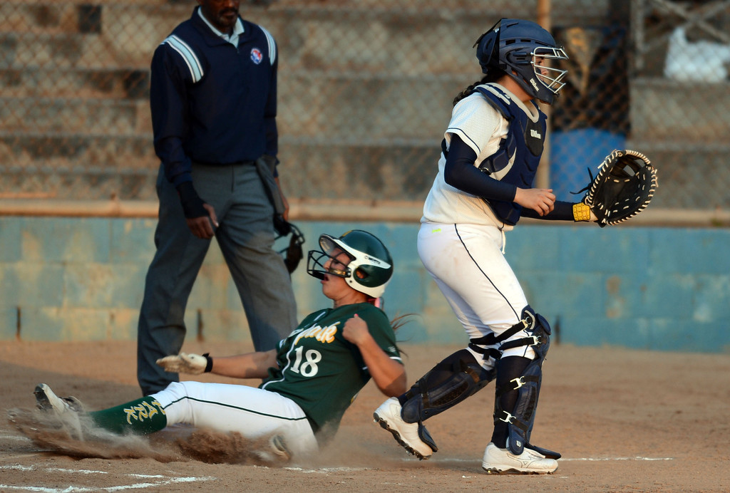 . North catcher Bryanna Ybarra awaits a throw that comes too late as Moorpark\'s Amanda Lorenz (18) scores in a pool play softball game of the TNT Tournament at Wilson Park in Torrance. 20130321 Photo by Steve McCrank / Staff Photographer