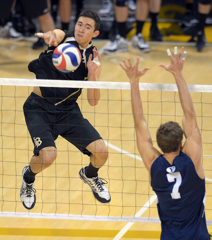 . LBSU\'s Ian Satterfield hits over BYU\'s Phil Fuchs in Long Beach, CA on Friday, March 7, 2014 #2 BYU vs #3 Long Beach State men\'s volleyball at Walter Pyramid. (Photo by Scott Varley, Daily Breeze)