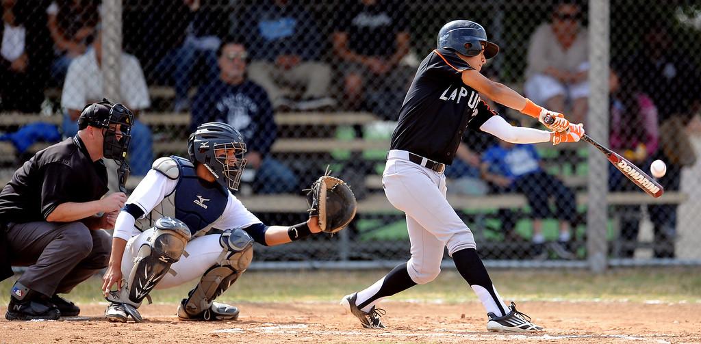 Description of . La Puente Tizoc Monarrez in the second inning of a prep baseball game against Duarte at Duarte High School on Thursday, April 25, 2012 in Duarte, Calif. Duarte won 4-3.    (Keith Birmingham/Pasadena Star-News)