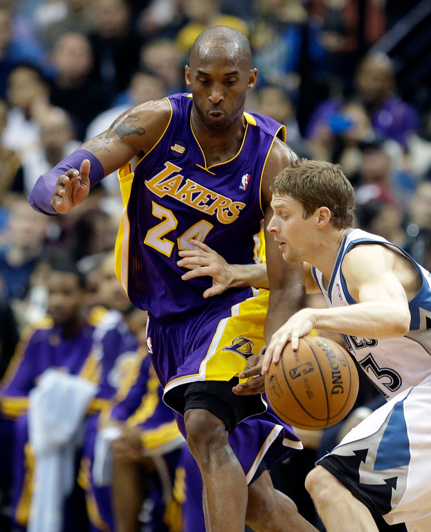 . Minnesota Timberwolves\' Luke Ridnour, right, drives against Los Angeles Lakers\' Kobe Bryant in the second half of an NBA basketball game Wednesday, March 27, 2013 in Minneapolis. The Lakers won 120-117. (AP Photo/Jim Mone)