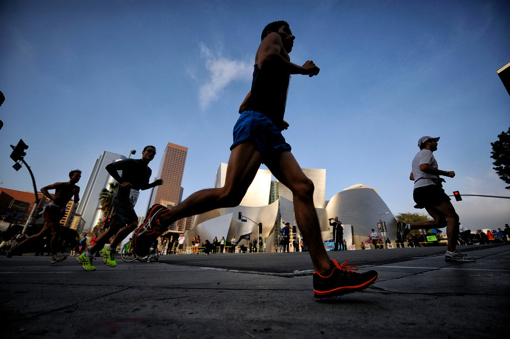 . Competitors make their way along 1st Street in Los Angeles during the Los Angeles Marathon Sunday, March 17, 2013. (Hans Gutknecht/Staff Photographer)