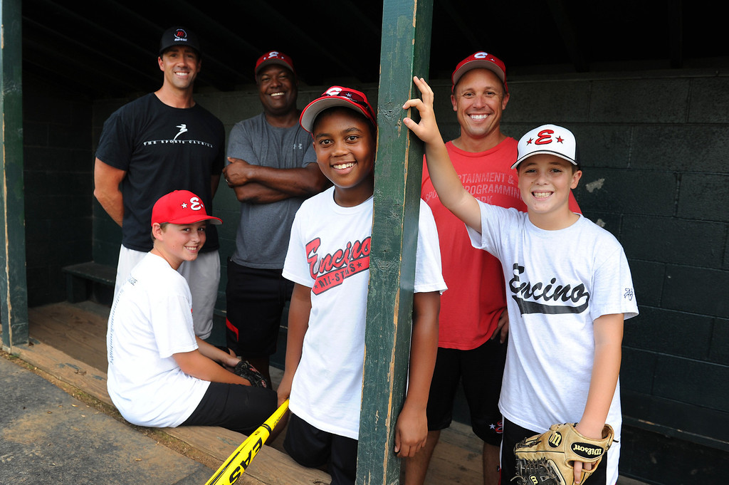 . Encino\'s 11-under all-star baseball players Tyler Stromsborg, front left, with is father assistant coach Ryan Stromsborg, Robinson Peete, front center, with his father Rodney Peete and Jake Dicker with his father head coach Kevin Dicker. (Michael Owen Baker/L.A. Daily News)