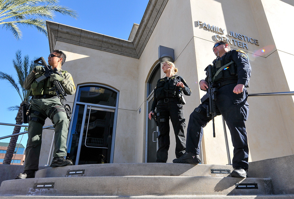 . Multiple law enforcement agencies watch for suspicious activity around the Riverside County District Attorney\'s office in Riverside on Monday, Feb. 11, 2013. Police were stationed in the area as the Riverside County District Attorney held a press conference to give the latest updates in the Christopher Dorner manhunt. (Rachel Luna / Staff Photographer)