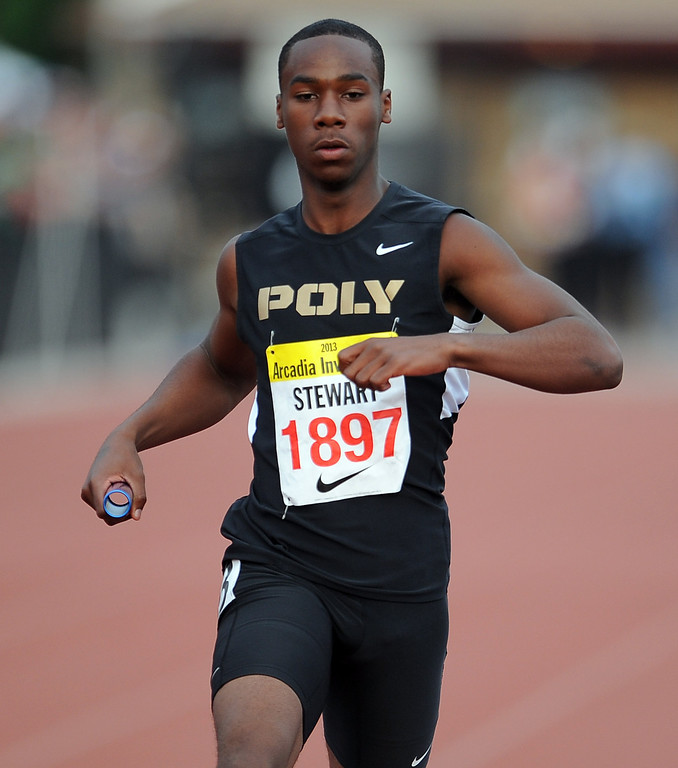 Description of . Long Beach Poly's Kyle Stewart runs the 4x200 rated race during the Arcadia Invitational at Arcadia High School on Friday, April 5, 2013 in Arcadia, Calif.  (Keith Birmingham Pasadena Star-News)