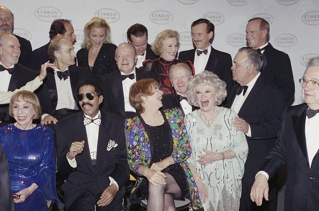 ". Jonathan Winters\', right, middle row, droll humor draws guffaws from comedy greats waiting for a group photo at the taping of NBC\'s second annual ""Comedy Hall of Fame\"" shown on Sunday Aug. 29, 1994 in Beverly Hills, California. Left to right, front are Richard Pryor, Shirley Maclaine and Phyllis Diller; middle, Sid Caesar, Bob Hope, Nanette Fabray, Red Buttons; rear, Phil Hartman, Dick and Tom Smother. Honored for their lifetime achievement were Hope, Maclaine, and Sid Caesar, Mary Tyler Moore, George Carlin and Richard Pryor. (AP Photo/Reed Saxon)"