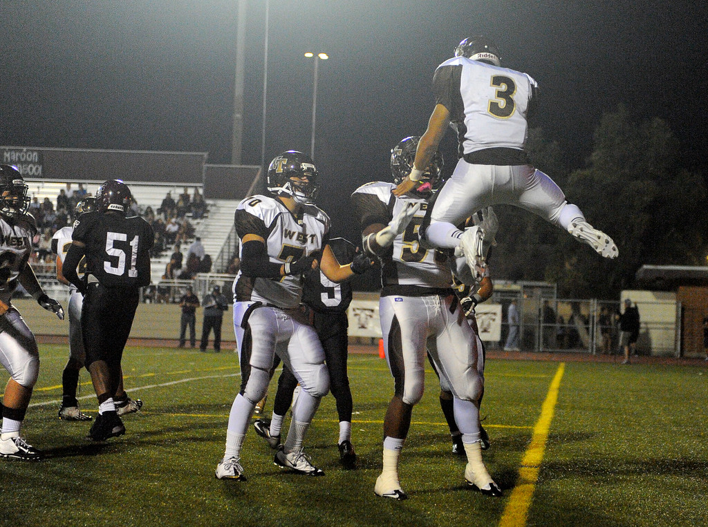 . West High takes on Torrance in a non league football game at Zamperini Stadium in Torrance, CA on Thursday, September 12, 2013. West\'s Nate Kutaka (3) celebrates his 2nd qtr TD. (Photo by Scott Varley, Daily Breeze)