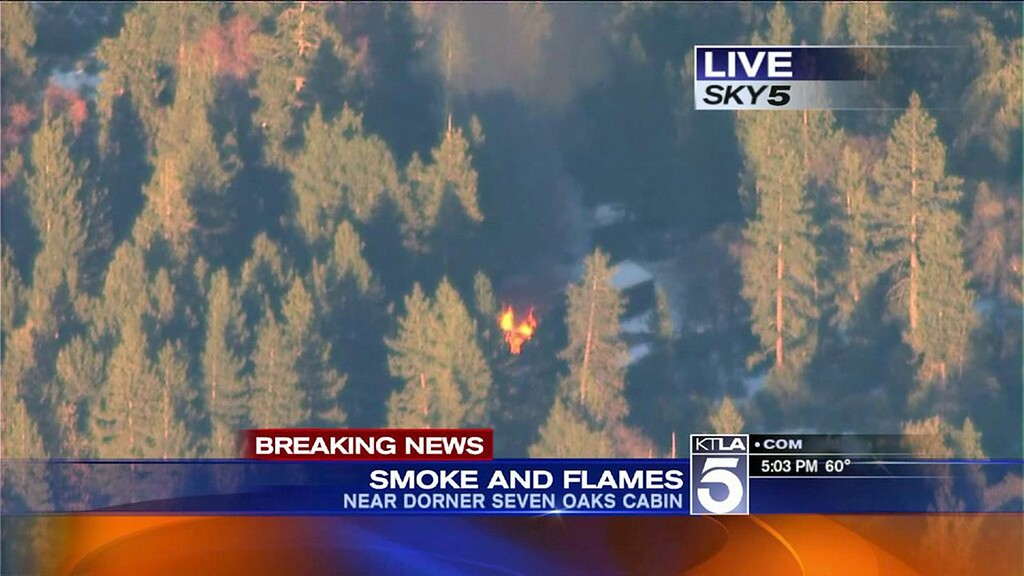 Description of . A photo from KTLA 5 News helicopter shows a burning cabin, where police believe Christopher Dorner may be. The cabin is located in the Seven Oaks area of the San Bernardino Mountains. Mandatory Credit: KTLA5NEWS