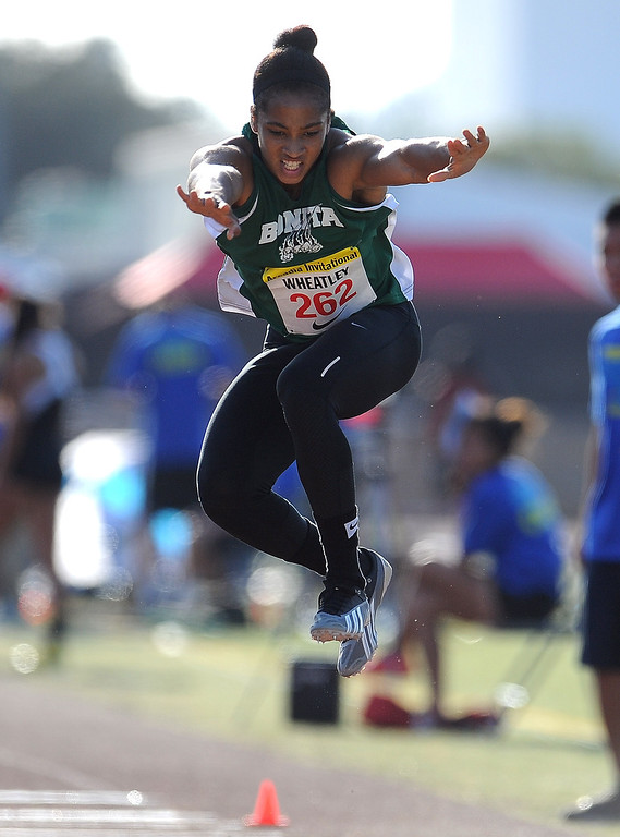 Description of . Bonita's Dominique Wheatly competes in the triple jump during the Arcadia Invitational at Arcadia High School on Saturday, April 6, 2013 in Arcadia, Calif.  (Keith Birmingham Pasadena Star-News)