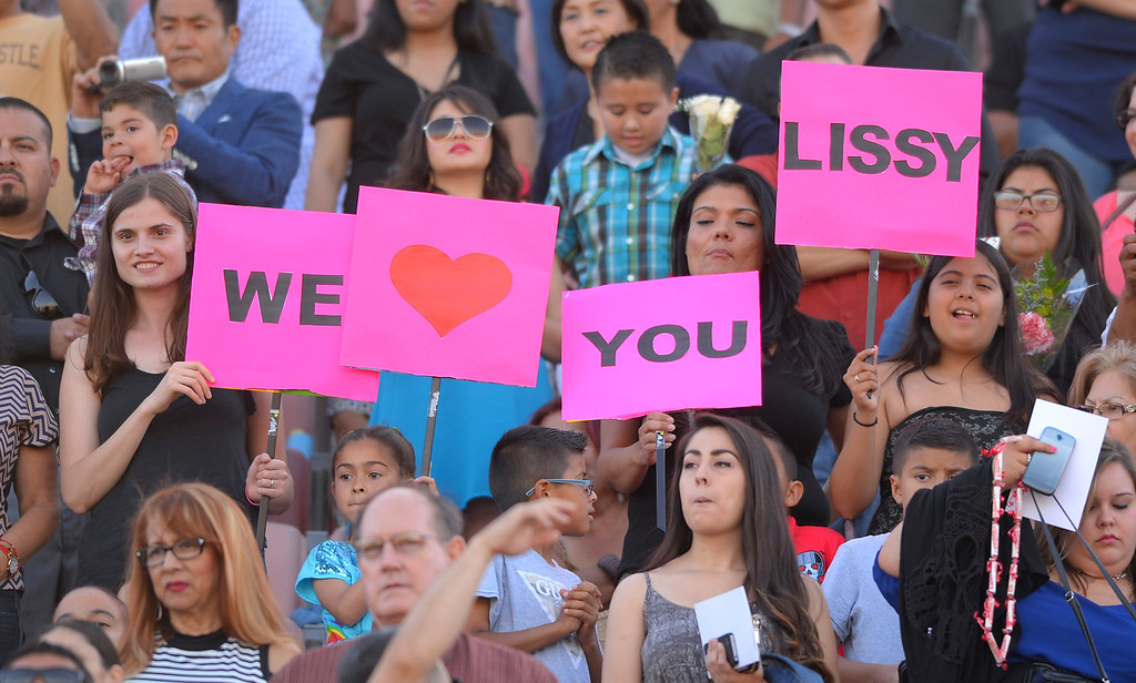 . Family members cheer on graduates at Long Beach City College\'s class of 2014 graduation at Veterans Memorial Stadium in Long Beach, CA on Thursday, June 5, 2014. (Photo by Scott Varley, Daily Breeze)
