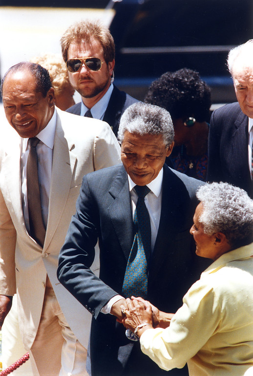 . June 1990: Nelson Mandela is greeted by an unidentified person on Spring Street at side of Los Angeles City Hall.  Daily News file photo
