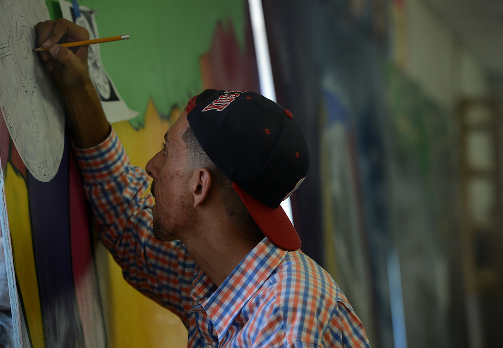 Description of . Pomona youths continue working on a mural at the San Gabriel Valley Conservation Corps YouthBuild Charter School in Pomona, CA, Wednesday, August 13, 2014. (Photo by Jennifer Cappuccio Maher/Inland Valley Daily Bulletin)