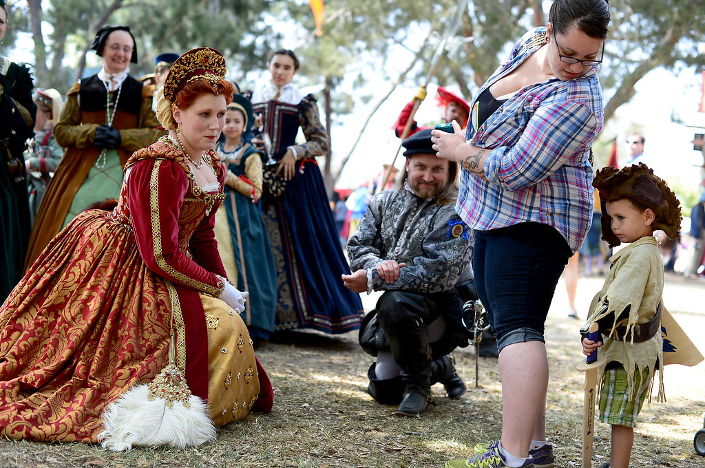 Description of . The queen and her court approaches Wyatt Adams, 3, of Santa Ana, and his mom Frankie on opening day of the Renaissance Pleasure Faire Saturday, April 6, 2013 at Santa Fe Dam Recreation Area in Irwindale. The fair runs through May 19. (SGVN/Staff Photo by Sarah Reingewirtz)