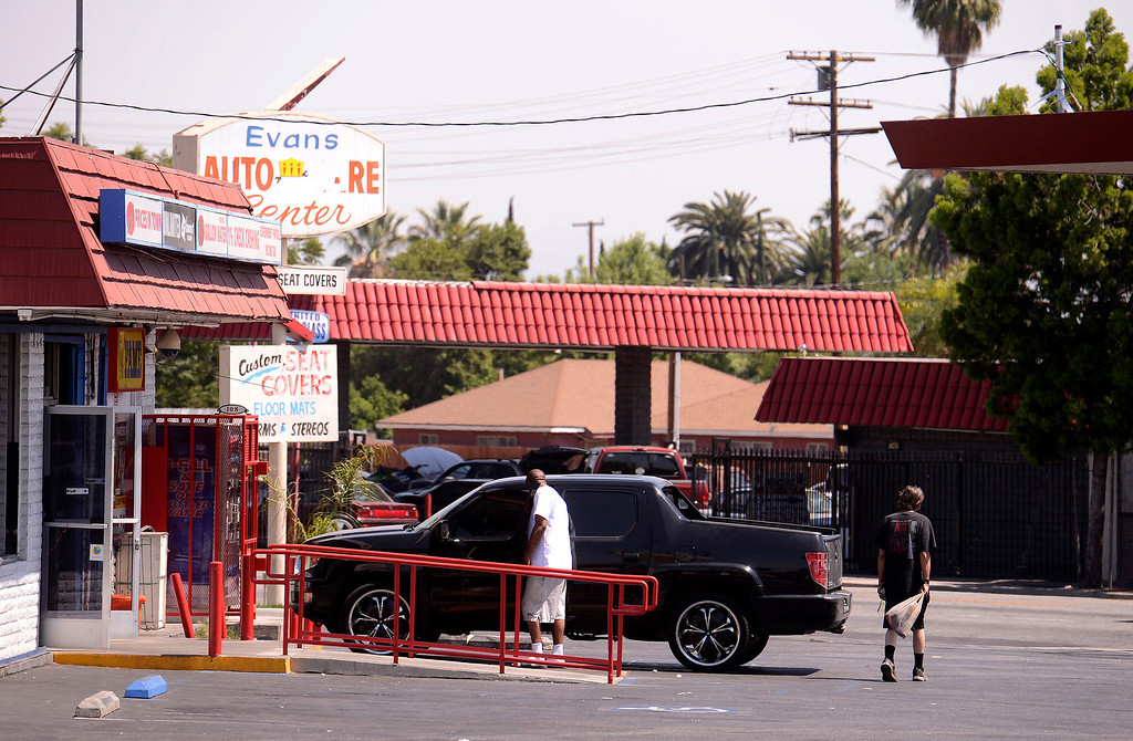 . A view of Fame Liquor store on the corner of North Sierra Way and Baseline Street in San Bernardino April 22, 2013.   GABRIEL LUIS ACOSTA/STAFF PHOTOGRAPHER.