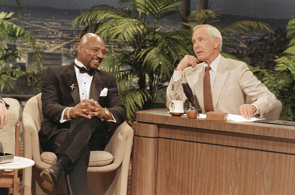 """. Middleweight boxing champion \""""Marvelous\"""" Marvin Hagler, left, talks to NBC-TV\'s Tonight Show host Johnny Carson about his boxing career Tuesday, May 14, 1986 in Burbank, Calif. He said he would announce next month if he will accept a challenge from \""""Sugar\"""" Ray Leonard to meet in the ring. (AP Photo)"""