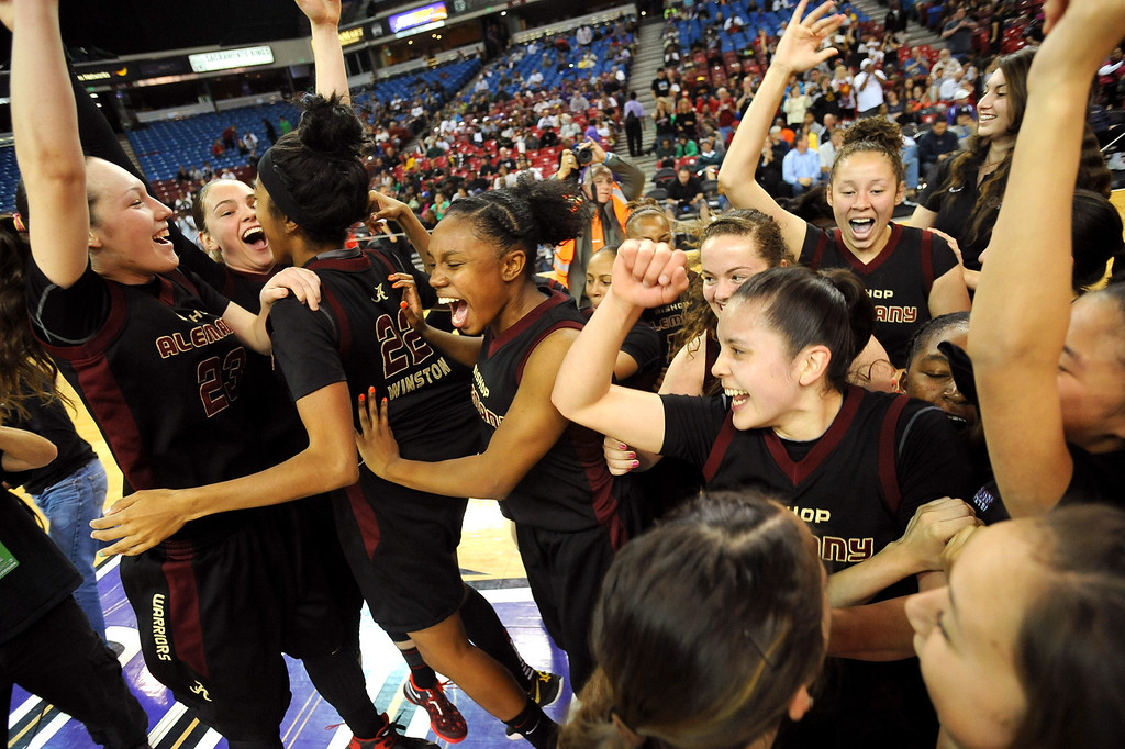 . Alemany High School players celebrate after defeating Sacred Heart Cathedral in the Div. III 2013 CIF State Basketball Championship game at the Sleep Train Arena, in Sacramento, Ca March 22, 2013.(Andy Holzman/Los Angeles Daily News)