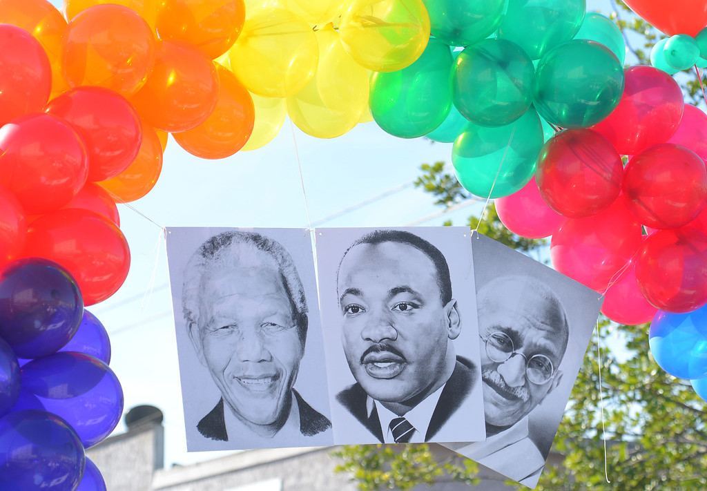 . The 26th Annual Martin Luther King, Jr., Peace & Unity Parade Saturday, January 18, 2014, Long Beach, CA.   Martin Luther King Jr.\'s image appears in between Nelson Mandela and Gandhi. Photo by Steve McCrank/Daily Breeze