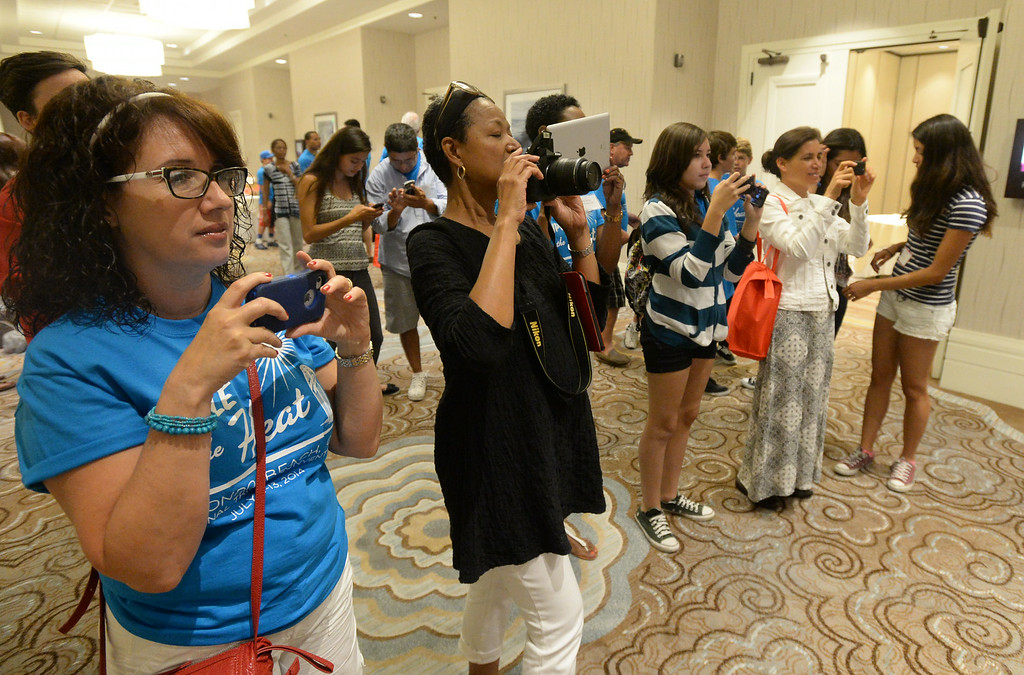 . Triplets from around the globe converged at the Crowne Plaza Hotel for the National Triplet Convention Saturday, July 12, 2014, Redondo Beach, CA  Parents of the triplets take photos. Photo by Steve McCrank/Daily Breeze