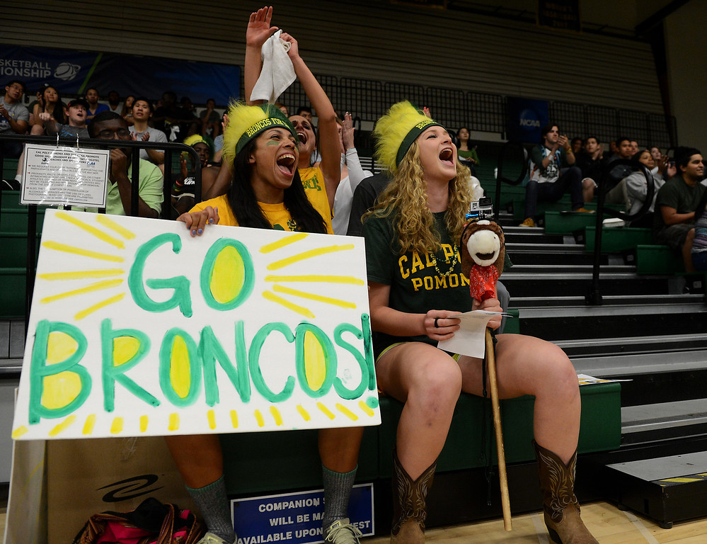Description of . Cal Poly Pomona students Christen Williams, left, and Alexandra Hasen cheer as Cal Poly Pomona makes a basket against Montana State Billings during the NCAA Division II West Regional championship game at Cal Poly Pomona in Pomona, CA, Monday, March 17, 2014. (Photo by Jennifer Cappuccio Maher/Inland Valley Daily Bulletin)