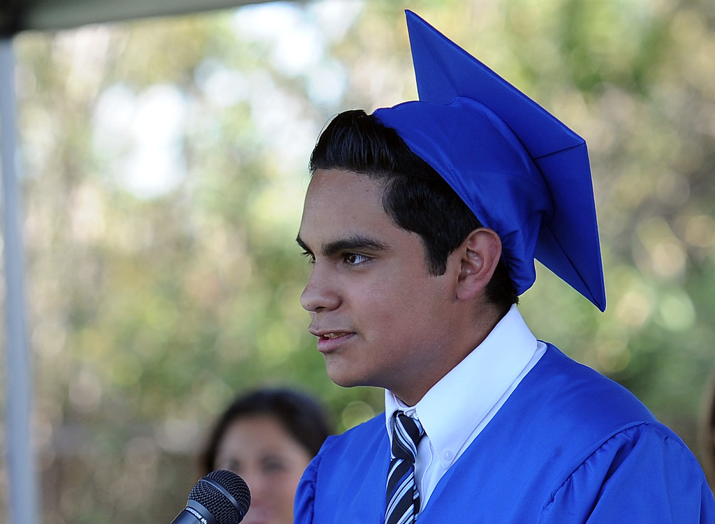 Description of . Marco Vazquez gives the student address during the El Camino High School commencement at El Camino High School on Wednesday, June 19, 2013 in Whittier, Calif.  (Keith Birmingham/Pasadena Star-News)