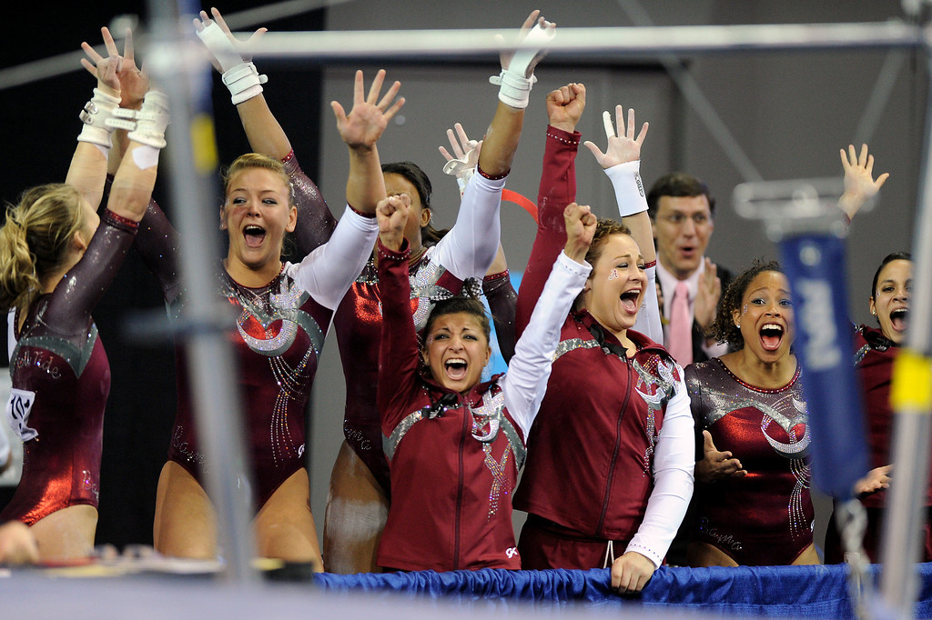 . Alabama cheers during the uneven parallel bars at the NCAA Women\'s Gymnastics Championship Team Finals at Pauley Pavilion, Saturday, April 20, 2013. Alabama finished third in the competition. (Michael Owen Baker/Staff Photographer)