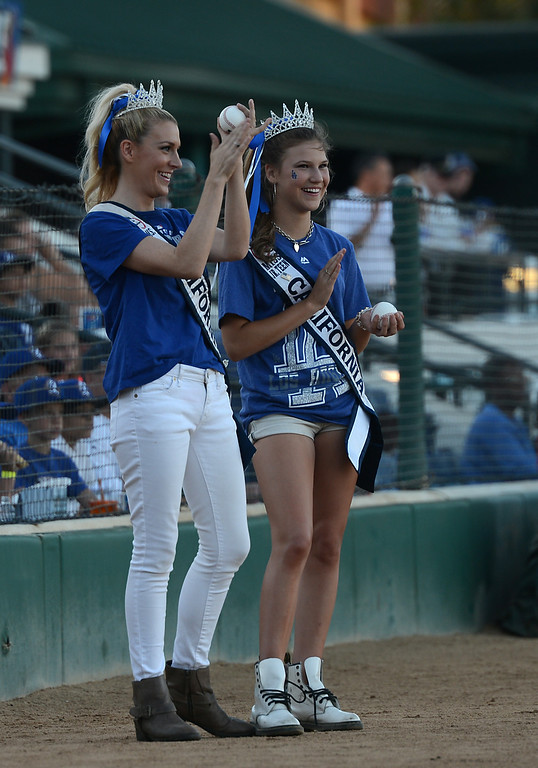 Description of . Ms. California 2014 Sande Charles and Ms. Jr. Teen California Alina Carranza clap after they and Actor Fred Willard throw out the first pitches at the Quakes game at LoanMart Field in Rancho Cucamonga, CA, Friday, August 15, 2014. (Photo by Jennifer Cappuccio Maher/Inland Valley Daily Bulletin)