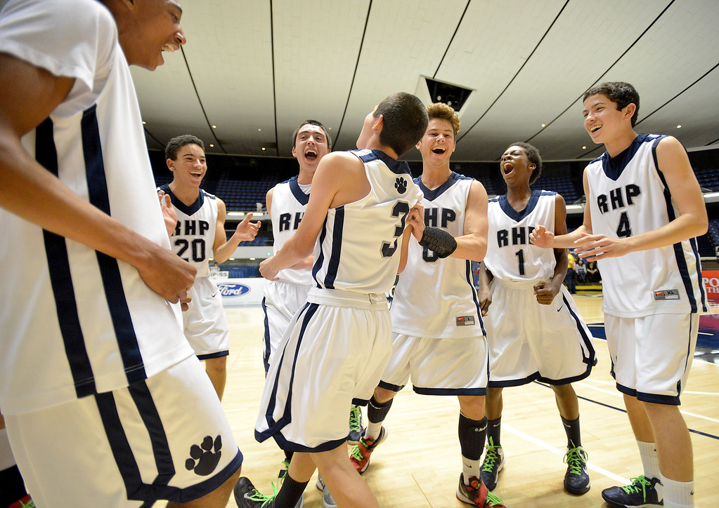 . 02-28-2012--(LANG Staff Photo by Sean Hiller)- Ray Estrada (3) ,center, leads teammates in a celebratory dance after Rolling Hills Prep beat Shalhevet 50-36 in Thursday\'s boys basketball CIF SS Div. 5-A title game at the Anaheim Convention Center Arena in Anaheim.